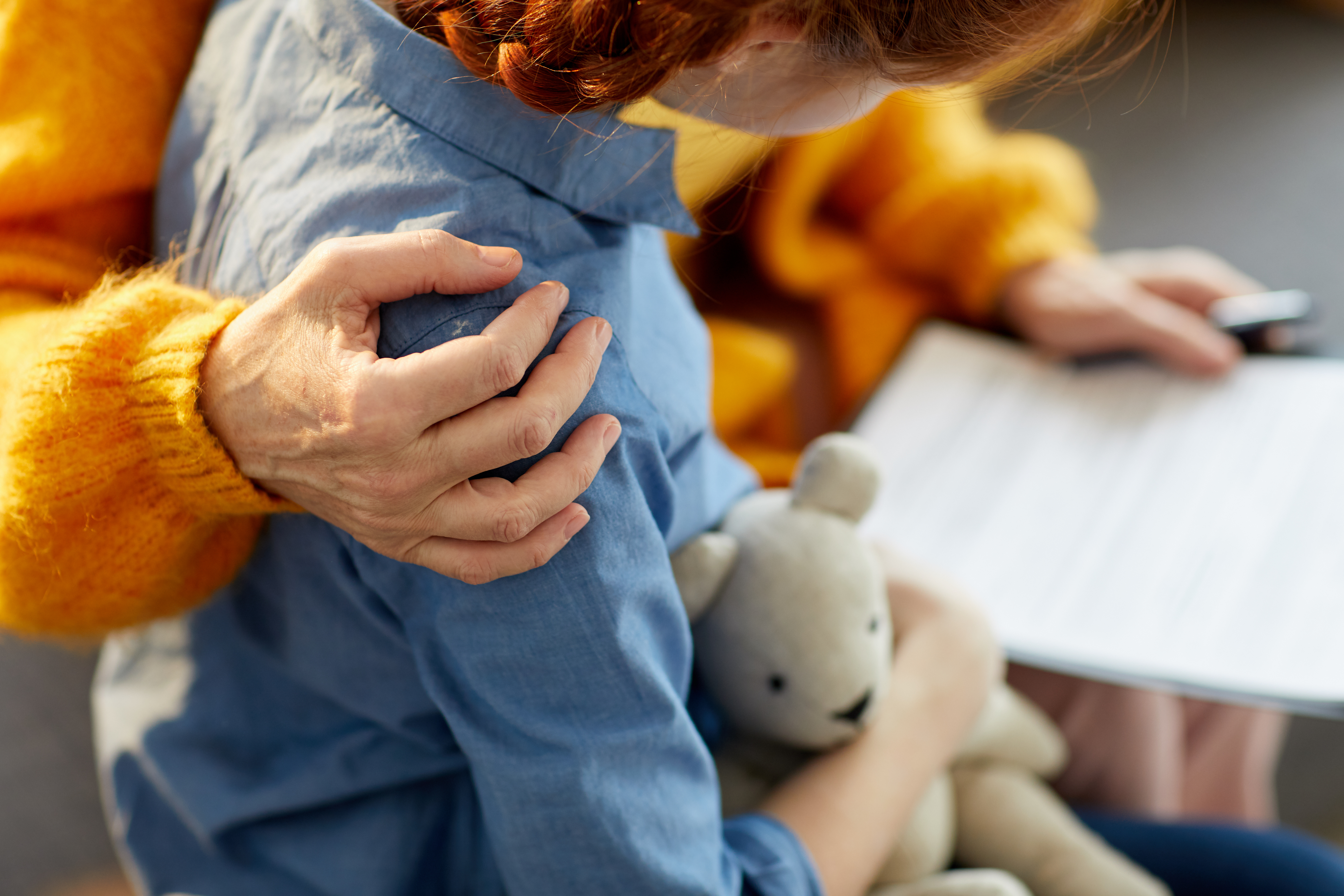 Child with hug and bear